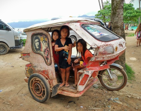 some kids in a tricycle
