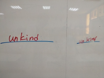 For this round I would say the team on the left won because the d on the end of 'unkind' is unreadable.